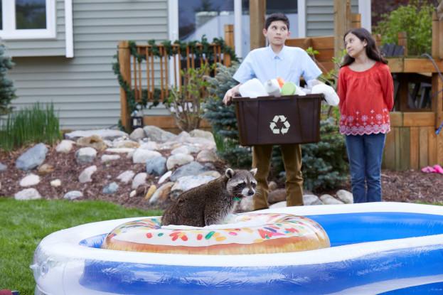 Two kids in front of kiddie pool