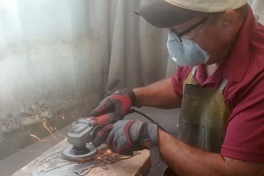 Man creating art from recycled metal