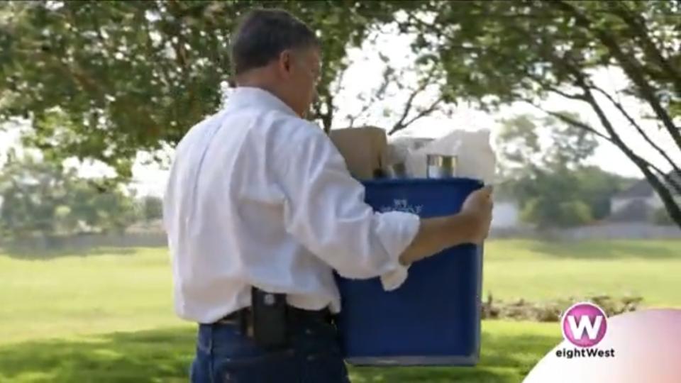 Man holding full reycling bin