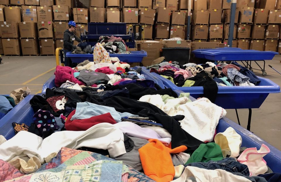 Piles of sorted clothing at Goodwill Industries of Greater Grand Rapids are prepared for recycling