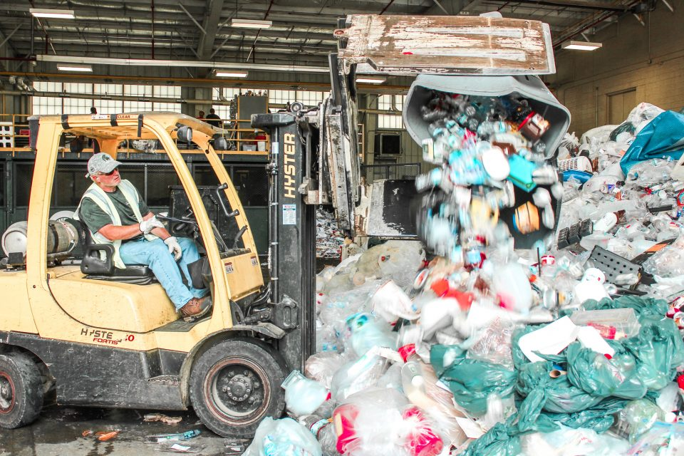 A forklift works to move plastic materials at the Michigan State University Surplus Store and Recycling Center